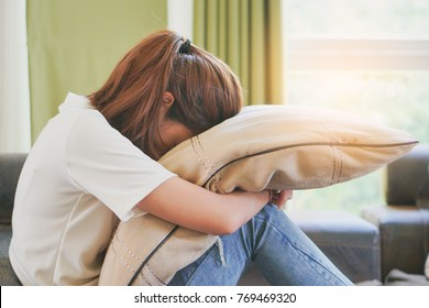 asian teenage feeling depressed and lonely in the house. Stressed female from university study.