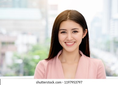 Asian teenage girl have a beautiful face. good health makes the skin look good. beautiful hair caused care of the treatment. Use vitamins in care of the body. Make it look younger than real age.
