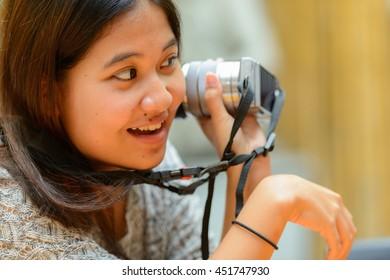 Asian teenage girl photographing