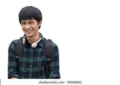 Asian teenage student holding books isolated on white