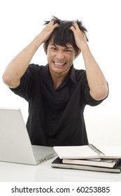 Asian teenage student pulling his hair out from frustration