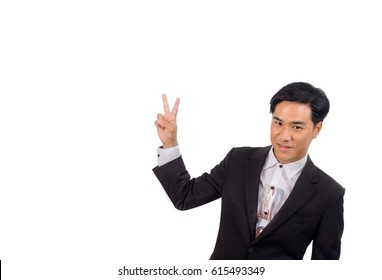 An Asian teenager boy in black suit and white shirt inside shows number two by his fingers.