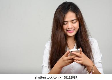 Asian teenager girl using mobile phone