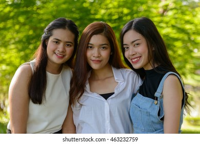 Asian teenager girls outdoors in park