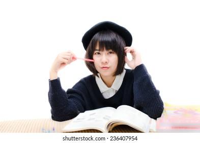 Asian teenager reading books.