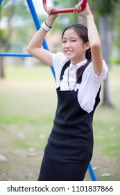 asian teenager toothy smiling face standing in public park