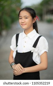asian teenager wearing black and white shirt toothy smiling face outdoor