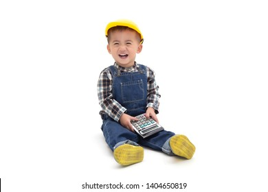 Asian Thai baby boy wearing an engineer suit with hard hat and holding calculator isolated on white background, Construction worker concept, One year six month old