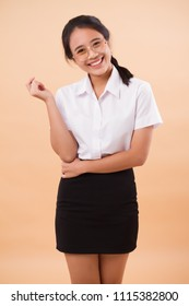 asian thai college woman nerd student in uniform; happy smiling asian thai university nerd woman student; concept of college education, university study; asian young adult woman model