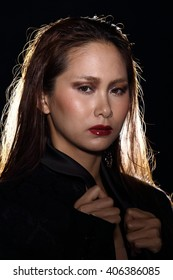 Asian Thai Female Model People with Fashion Make Up style in Dark background with Studio Lighting