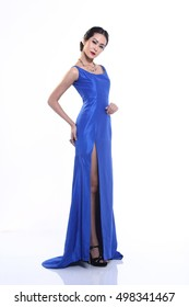Asian Thai Female Model with Tan Skin on Blue Evening Gown Dress, Fashion Make Up with white studio background
