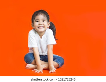 asian Thai girl face smile and fun on orange background with space