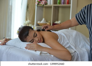 Asian Thai girl relax at Massage spa with Aromatherapy oil and hrebs.A good way to bebefit girl mind and body is to relax by massage.Refreshing and  Restore body and mind after hard working.Succesful