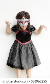 asian thai girl wearing dress and mask in halloween party and scare action