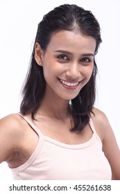 Asian Thai India Female Model Woman Tan Skin Smiling with perfect smile and white teeth in Pink Vest with Studio Lighting, Healthy Teeth concept
