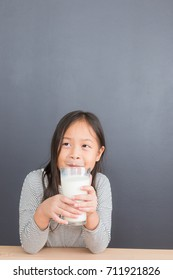Asian thai kid cute girl age 6 year happy to drink milk