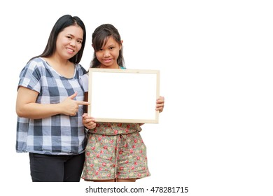 Asian thailand mother and daughter smile holding blank board, isolated on white background with copy space. Board with blank can add your text or others. clipping path in picture.