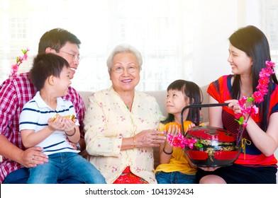 Asian three generations family celebrating chinese new year