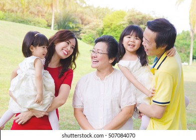 Asian three generations family enjoying outdoor nature