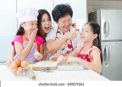 Asian three generations family having fun with baking in the kitchen