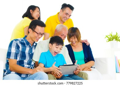 Asian three generations family using tablet computer