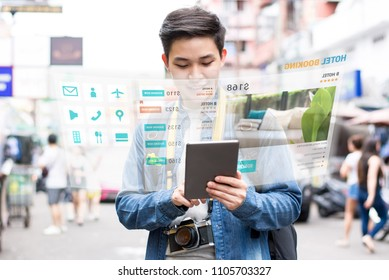 Asian tourist backpacker using mobile appication technology booking hotel online while traveling on vacations,  selective focus