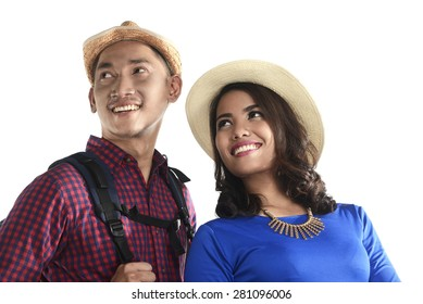 Asian tourist couple smiling isolated over white background