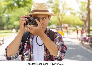 Asian tourist man taking photo in Sukhothai historical park, Northern of Thailand
