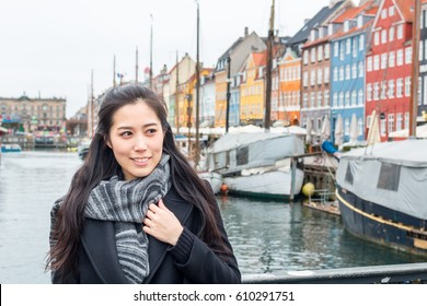 Asian tourist woman at Copenhagen, Nyhavn, Denmark. Tourist in Copenhagen, Travel and Lifestyle