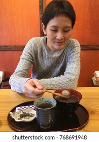 Asian tourist woman eat deserts in sweet shop.travel and leisure lifestly