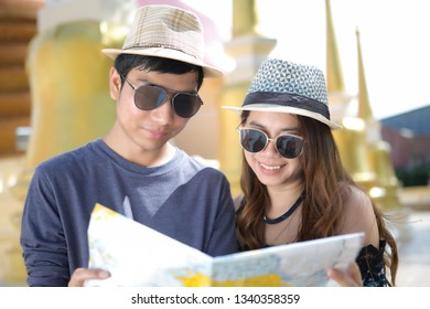 Asian tourists  looking on map