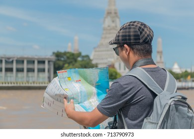 Asian tourists are watching the map before going out.