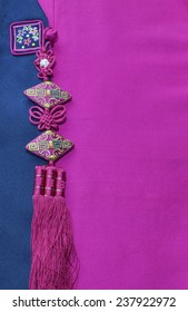 Asian Traditional Dress Detail (Hanbok) with an Ornament (Norigae/Chinese Knots)