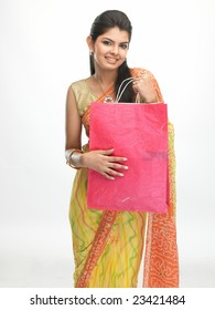 Asian traditional girl with sari carrying shopping bags