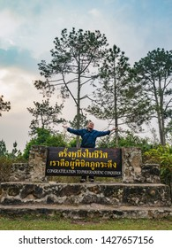 "Asian traveler with ""Congratulation to phukradueng conqueror""sign on the top of Phu Kradueng mountain national park in Loei City Thailand.Phu Kradueng mountain national park famous Travel destination"