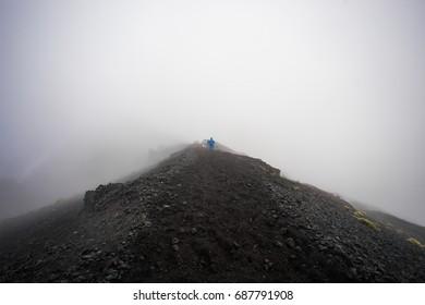 Asian traveling backpacker in volcano mountain Rinjani of Indonesia.