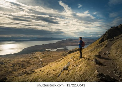 The asian traveller viewing the beautiful landscape scenery at the Old Man of storr, Isle of Skye, Scotland, United Kingdom