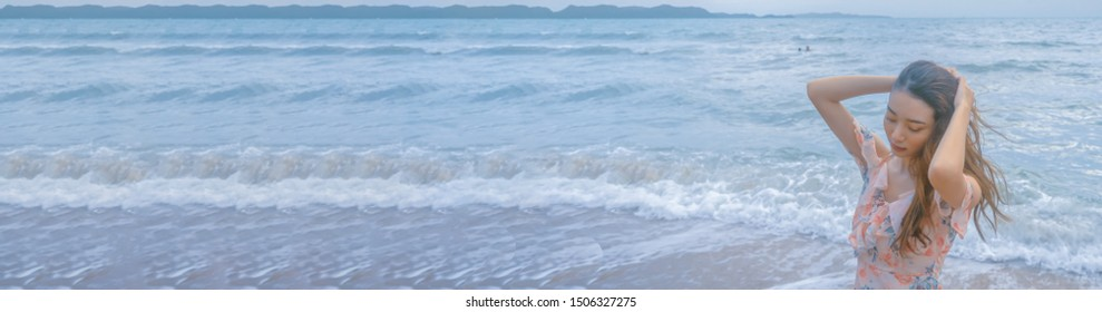 Asian traveller woman on the beach background on summer beach vacation holiday concept.