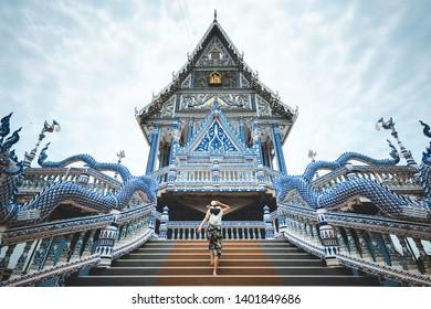 Asian traveller woman travel in Wat Pak Nam Khaem Nu temple, Chanthaburi, Thailand