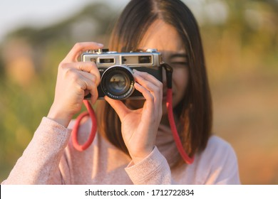 Asian travelling woman be smile with classic 35mm rangefinder film camera. Travel holiday concept