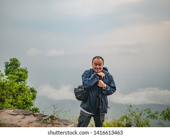 Asian Trekker with secnery view in the morning on Phu Kradueng mountain national park in Loei City Thailand.Phu Kradueng mountain national park the famous Travel destination