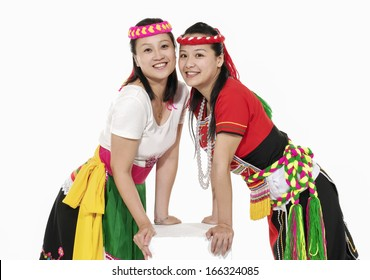 asian two woman in traditional dress with cube on white background