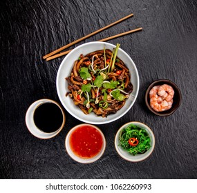 Asian Udon Noodles With Spicy Soy Sauce And Chicken Pieces Top View Served On