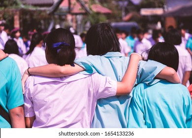 Asian uniform students hugging with love,Concept of best friends.
