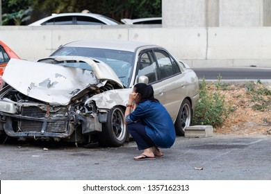 Asian upset driver woman in front of automobile crash car collision accident in city road