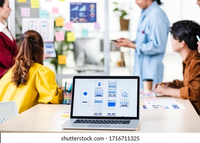 asian ux developer and ui designer presenting and testing mobile app interface design on whiteboard in meeting at modern office.Creative digital mobile app agency