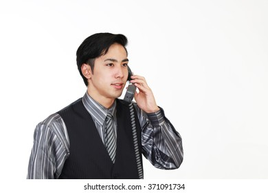 Asian waiter with a phone