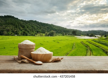 Asian white rice uncooked with the rice field background