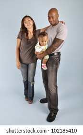 Asian wife, African American husband and their mixed race infant girl.