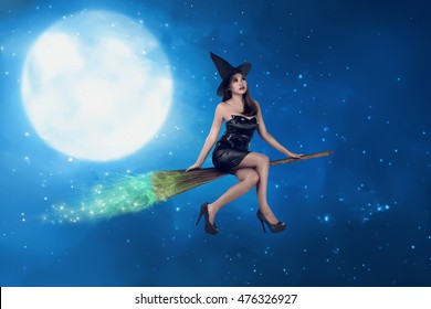 Asian witch woman ride the broom on the sky, in the night with moonlight background
